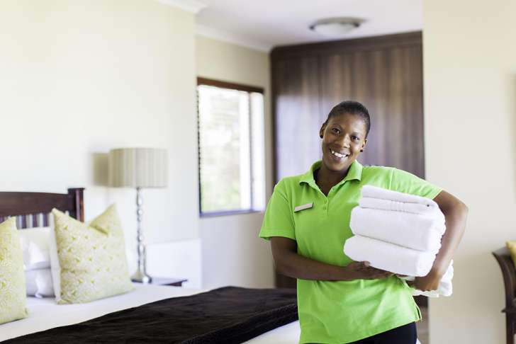 an image of a woman providing catering and housekeeping services