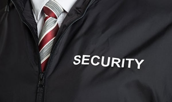 an image of someone in a jacket that has security printed on it