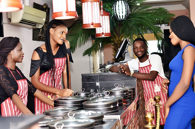 an image of people in a catering or restaurant setting - Ways Facility Management Supports Business Activities
