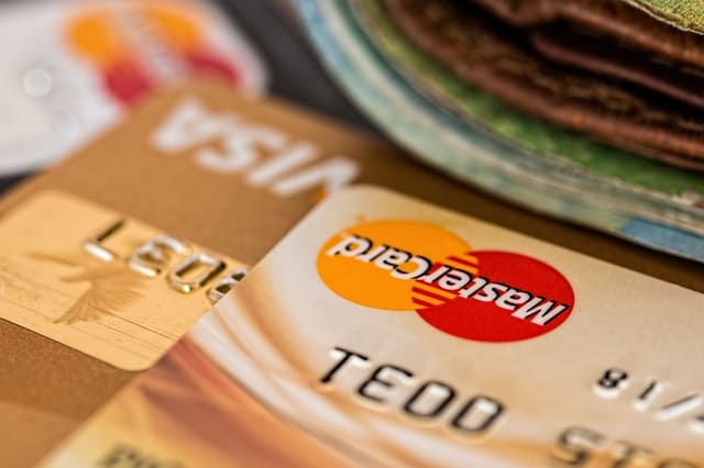 an image of some credit/debit cards - ways facilities management can save costs