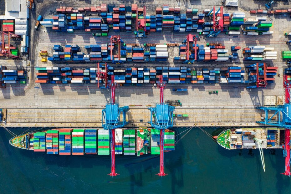 goods in ships and at a dock to show procurement and logistics at a port